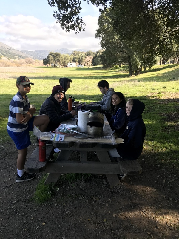 Group of scouts sitting at picnic table